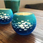 Round glass votive candle holder with fish decorative laser